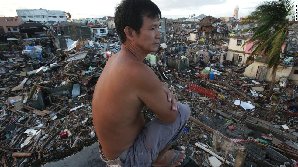 A man looks over the devastation from his damaged home in Tacloban on November 17.