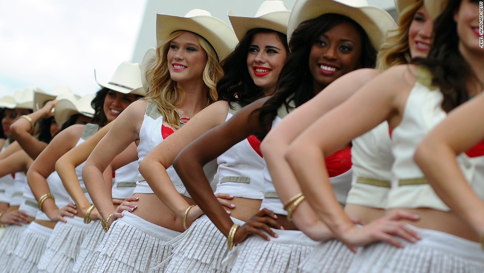 Guard of honor. The Texas grid girls line up with strict precision as they add their own touch of style and glamor to proceedings in Austin.