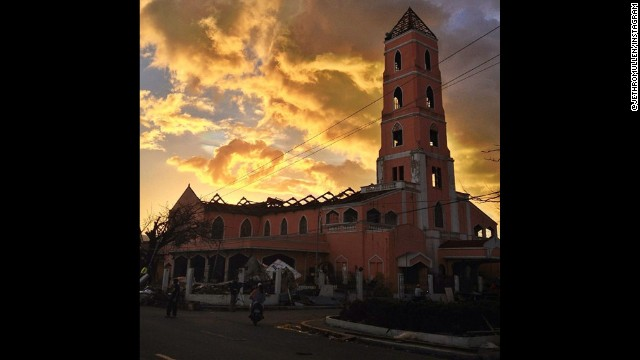 """The Santo Niño Church in Tacloban, the Philippines, which had its roof ripped off and interior flooded by Super Typhoon Haiyan this month. Despite the damage, the church has continued to function throughout the aftermath of the storm, providing people with a place to rest, pray and find support. Today, they planned to hold five masses there. You can read more about the situation at the church, and in Tacloban in general, on CNN.com"", says CNN's Jethro Mullen (@jethromullen) who took this image on November 17."
