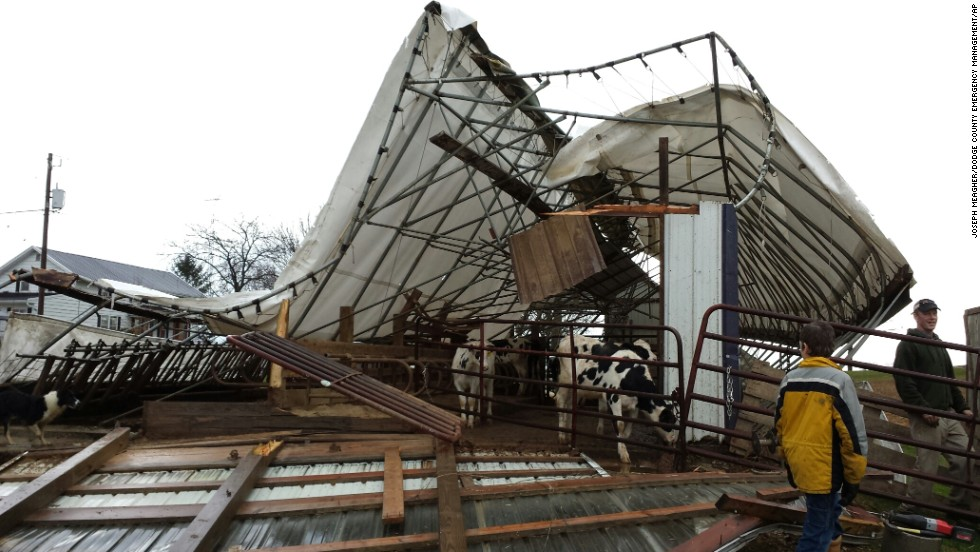 A damaged cattle shed sits on a family farm in Hustisford, Wisconsin, on November 17. Dodge County Emergency Management Director Joseph Meagher says no cattle were injured.