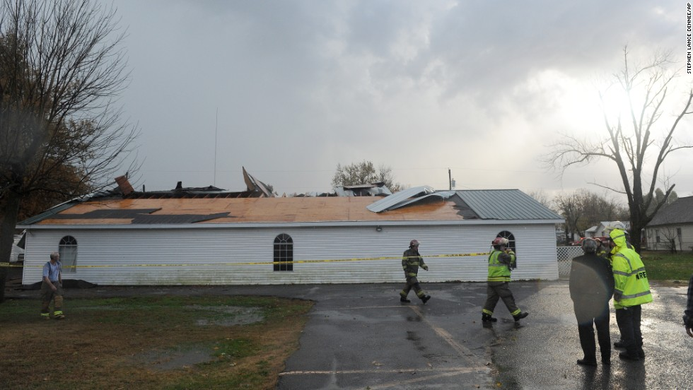 Firefighters stretch caution tape around the New Life Tabernacle Church in Paducah, Kentucky, on November 17.
