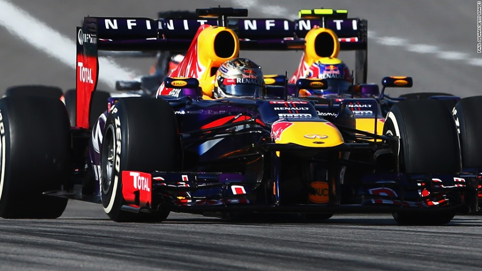 Red Bull teammates Vettel and Mark Webber are wheel to wheel at the start of the United States Grand Prix.