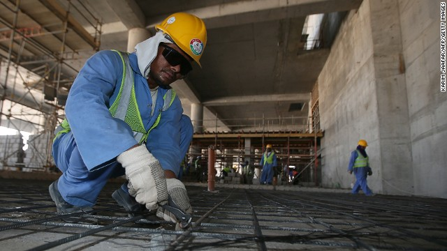 Migrant labourers work on a construction site on October 3, 2013 in Doha in Qatar. Qatar, the 2022 World Cup host is under fire over claims of using forced labour.