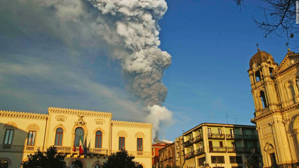 A tower of smoke and ash looms over the Sicilian town of Zafferana in January 2012. Etna eruptions are relatively frequent -- the past 12 months have seen a string of powerful lava fountains, flows and ash emissions.