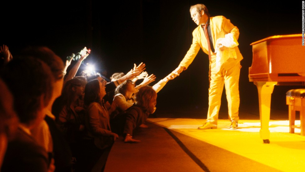 John shakes hands with fans in Canada in 1979.