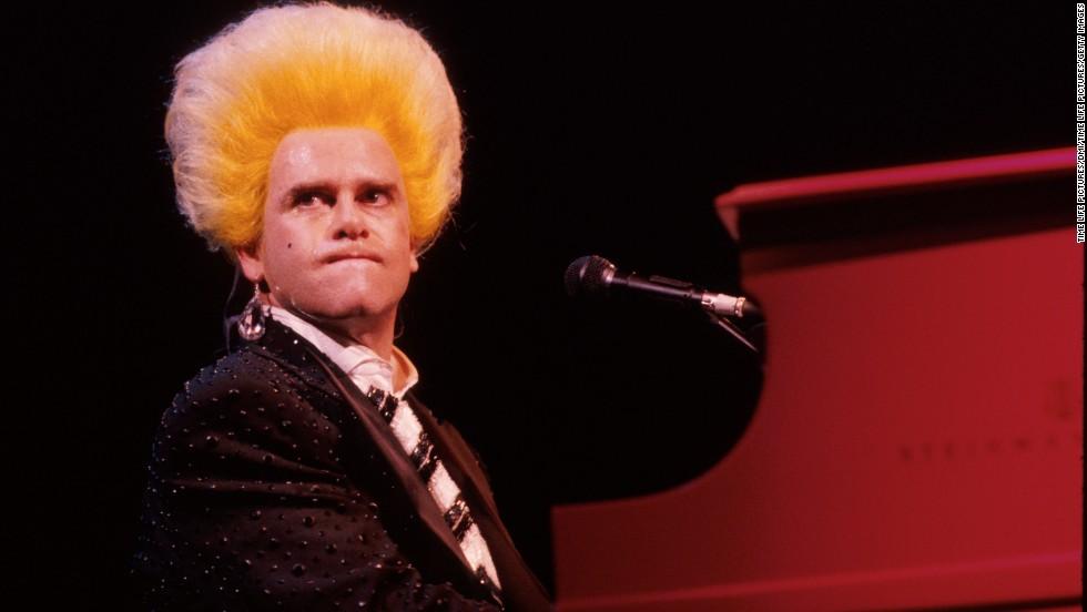 John performs in 1986.