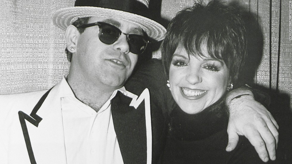 John poses with actress and singer Liza Minnelli in 1990.
