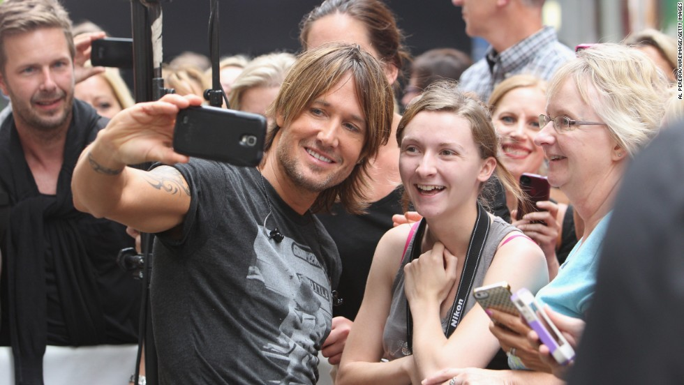 "Musician Keith Urban takes a selfie with a fan before performing at NBC's ""Today"" show."
