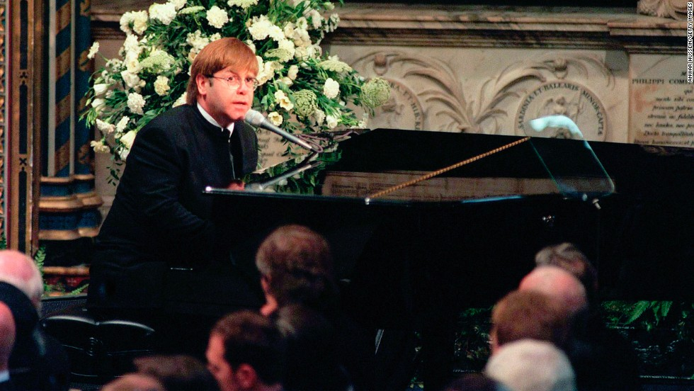 "John sings ""Candle in the Wind"" at the funeral for Princess Diana at London's Westminster Abbey in 1997."
