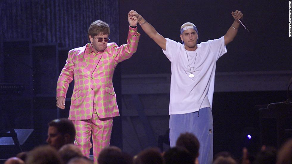 John and Eminem address the crowd after performing together at the Grammy Awards in 2001.