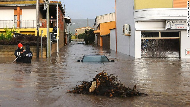 Rescuers work in a flooded street in the small town of Uras, Sardinia, Monday, Nov. 18, 2013. A violent rainstorm that flooded entire parts of the Mediterranean island of Sardinia has led to the deaths of at least nine people. Bridges were felled by swollen rivers and water levels reached 3 metres (yards) in some places.