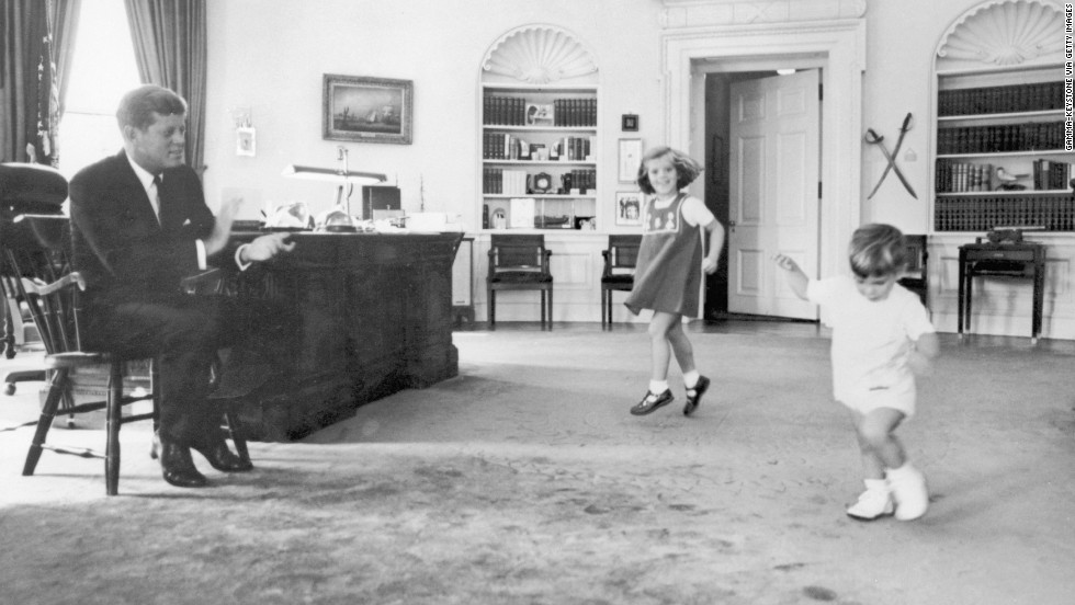Caroline and her brother dance to their father's claps in the Oval Office in 1962.