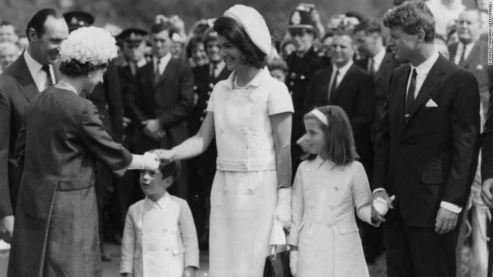 Caroline, alongside her mother and uncle Robert Kennedy, greet Queen Elizabeth II in London in 1965.