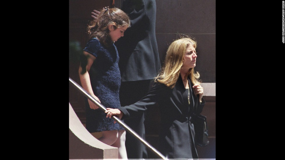 "Kennedy and her daughter Tatiana leave church in 1999 after a memorial Mass for her brother and his wife, Carolyn Bessette Kennedy. The couple died in a plane crash. <a href=""http://www.cnn.com/2012/05/16/politics/gallery/kennedy-tragedies/index.html"" target=""_blank"">Take a look at other Kennedy family tragedies.</a>"