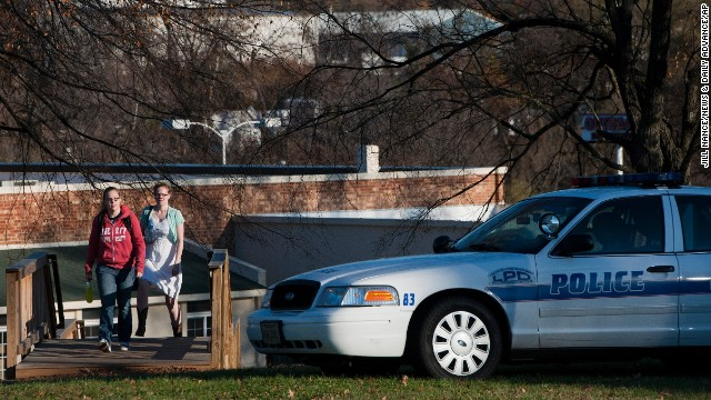 Liberty University students leave the Annex 2, an off-campus women's dorm, after an altercation between a student and a campus police officer resulted in the student being shot and killed.