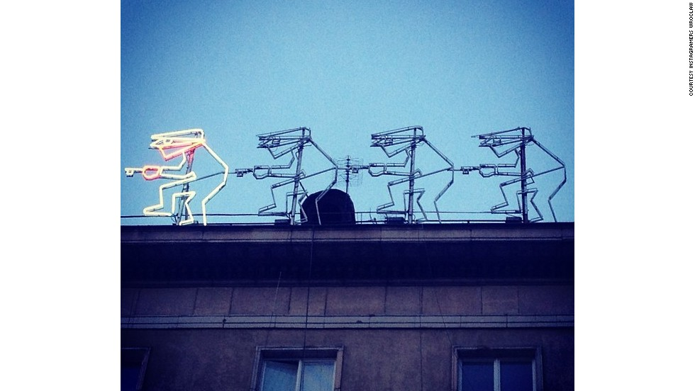 A neon sign on the roof of a building as captured by the Instagramers Wroclaw collective.