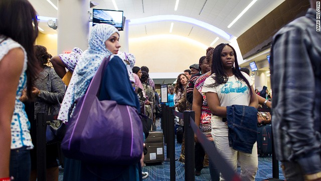 Passengers wait in line at the customs checkpoint inside the International Terminal at the Atlanta Airport.