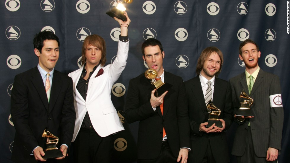 "Levine and Maroon 5 pose with their awards for ""Best New Artist"" during the 2005 Grammy Awards in Los Angeles."