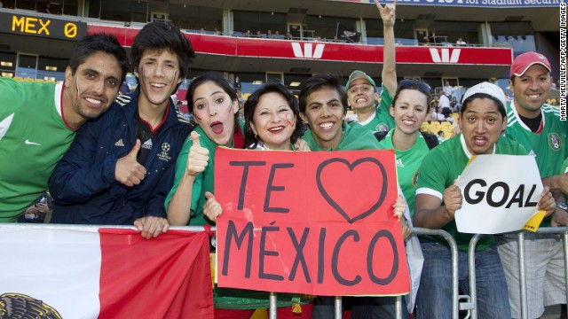 Mexican fans hold up signs before the start against New Zealand in their World Cup qualifying football match in Wellington on November 20, 2013.