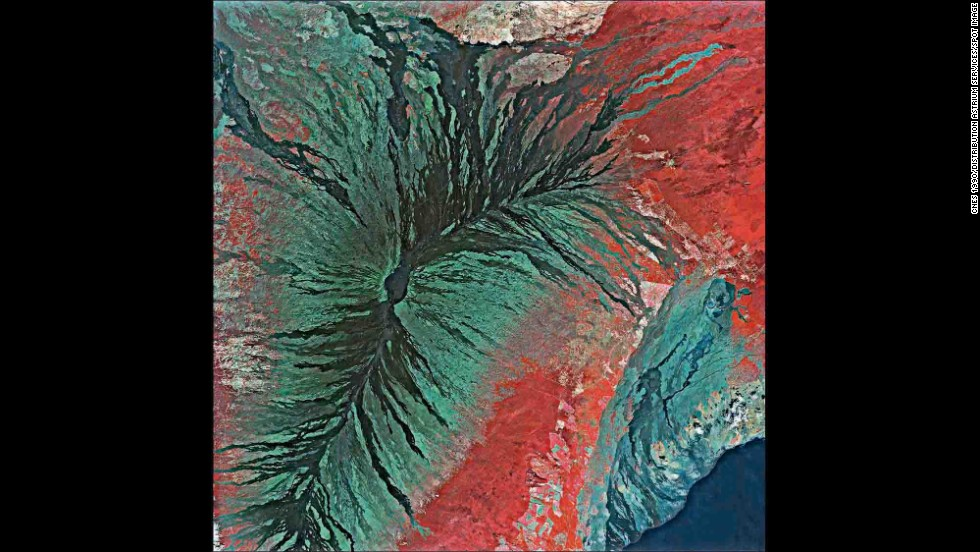 "A new book of photographs, ""Earth From Space,"" contains more than 150 high-resolution images shot from orbiting satellites. Seen from the perspective of hundreds of miles, many of Earth's features resemble abstract art. This image is of the Mauna Loa volcano on the big island of Hawaii."