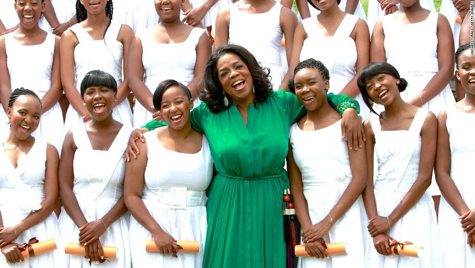 Oprah Winfrey is receiving the medal for her work as a broadcast journalist and her years of philanthropic work. Here, Winfrey poses with the 2011 graduates of the Oprah Winfrey Leadership Academy for Girls in Henley on Klip, South Africa.