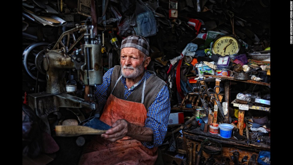This 84-year-old Turkish man manages a shoe repair shop that affords him a decent income.