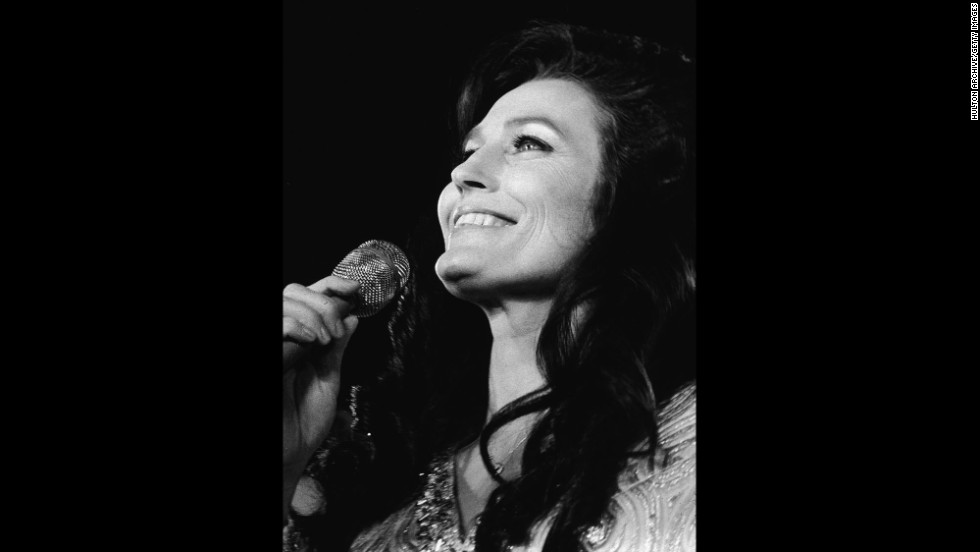 """Country music singer Loretta Lynn stood out in the male-dominated industry in the early 1960s and """"emerged as one of the first successful female country music vocalists,"""" according to the White House."""