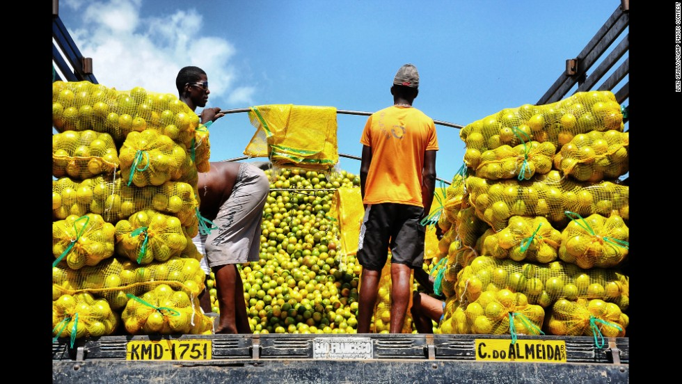 These men are preparing to sell oranges at the São Joaquim Market in Salvador, Brazil.