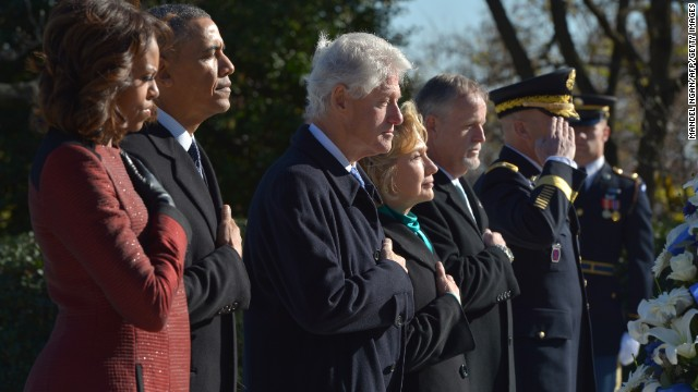 US President Barack Obama, First Lady Michelle Obama along with former president Bill Clinton and former secretary of state Hillary Clinton take part in a wreath-laying ceremony in honour of the late 35th president of the US John F. Kennedy at Kennedy's gravesite in Arlington National Cemetery on November 20, 2013 in Arlington, Virginia. AFP PHOTO/Mandel NGAN        (Photo credit should read MANDEL NGAN/AFP/Getty Images)