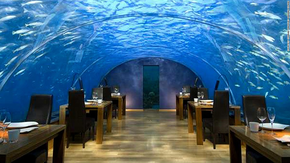 Extravagant spending, like this underwater restaurant in the Maldives, is easily justified when you're traveling. It's a one-time deal -- might as well make the most of it.