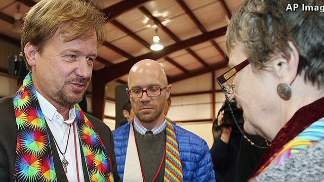 Lead intv Pastor suspended for officiating son's gay marriage_00003102.jpg
