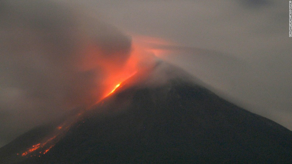 "Western Mexico's Colima volcano emits lava in October 2004. The Global Volcanism Program reported ""a bright thermal anomaly"" as well as gas emission in November 2013."