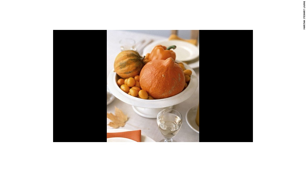 Autumn centerpiece: Orange fruits and vegetables make up this market-fresh centerpiece.