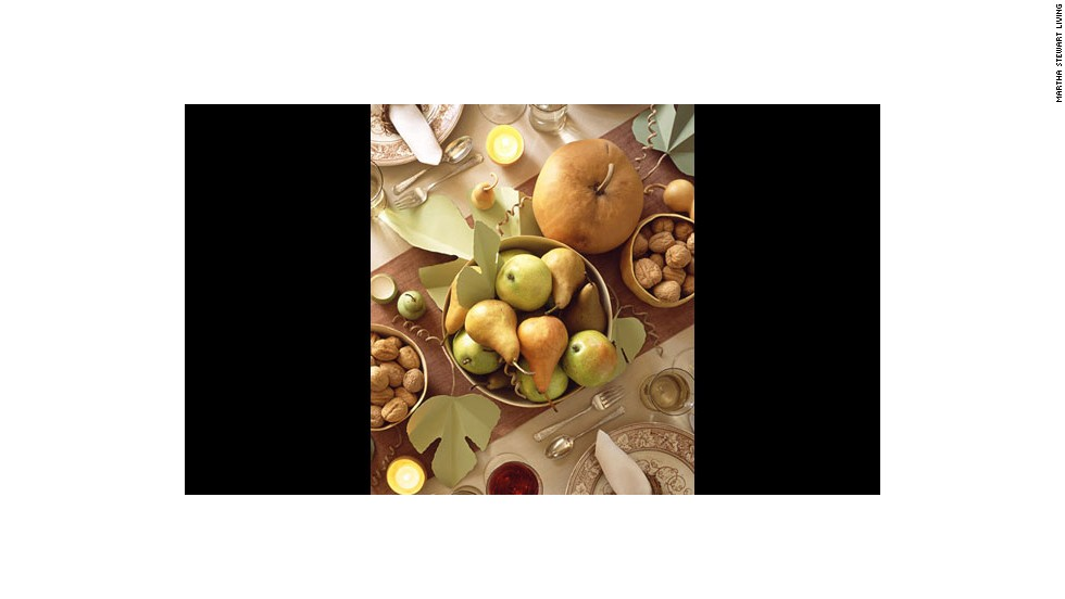 """Harvest table: This centerpiece is <a href=""""http://www.marthastewart.com/264215/setting-a-thanksgiving-table"""" target=""""_blank"""">grounded by hollowed-out gourds</a>."""