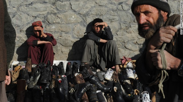 Afghan vendors sell shoes by a roadside on Wednesday as Kabul prepares for the Loya Jirga.