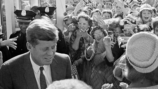 President John F. Kennedy and his wife Jacqueline Kennedy arrive in Dallas, Texas, hours before he was killed on November 22, 1963.
