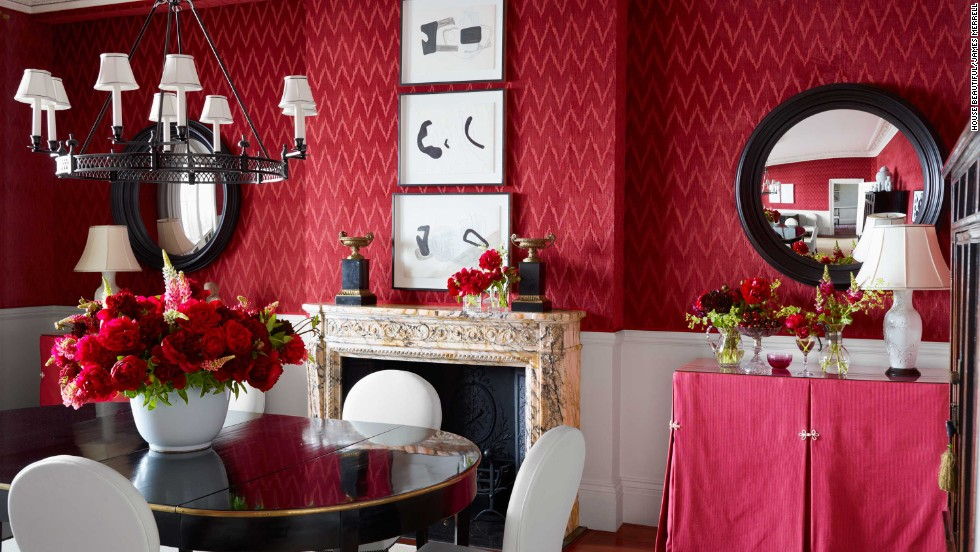 House Beautiful editor Shax Riegler says red is the most popular color for a dining room. Here, Rob Southern's dining room, featured in the October 2013 issue of House Beautiful, has traditional red walls done in a luxurious wallpaper.