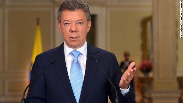 "Handout picture released by the Colombian presidential press service showing Colombian President Juan Manuel Santos speaking at Narino Palace in Bogota on November 20, 2013. Santos announced that he will seek re-election next year. ""When you see the light at the end of the tunnel, you do not turn around and run the other way, "" the president said, referring to a peace process with Revolutionary Armed Forces of Colombia (FARC) guerrillas that is making strides but is not yet a done deal."