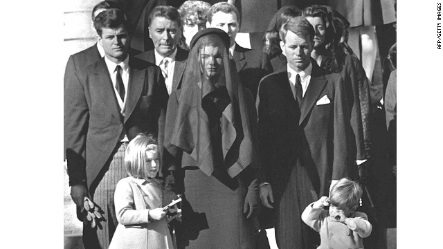 Jacqueline Kennedy stands with her two children Caroline Kennedy and John F. Kennedy Jr and brothers-in law Ted Kennedy (L, back) and Robert Kennedy (R) at the funeral of her husband US President John F. Kennedy 26 November 1963 in Washington, DC.