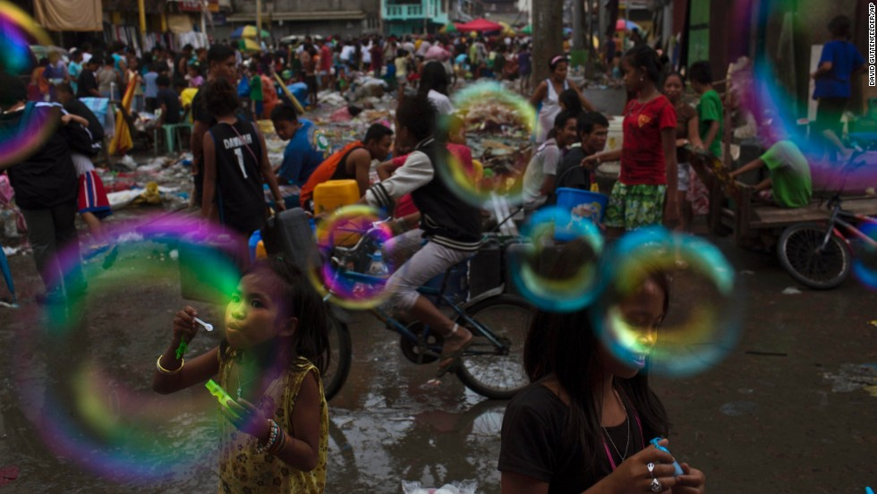 Children blow bubbles in the destroyed market of Tacloban, Philippines, on Wednesday, November 20.