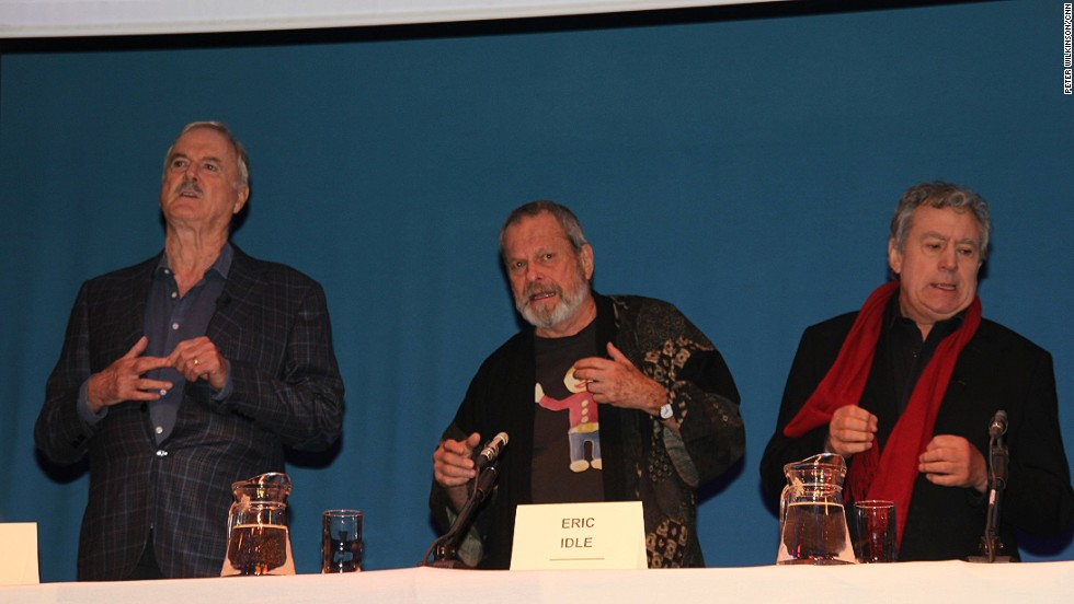 Cleese, Gilliam and Jones lark about at the news conference.
