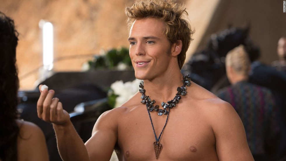 <strong>Weapon of Choice:</strong> Trident<strong>Shining Moment:</strong> Finnick and Katniss share a nice, quiet scene amid the madness of the arena, but he shines more literally in his barely-there gold ensemble.