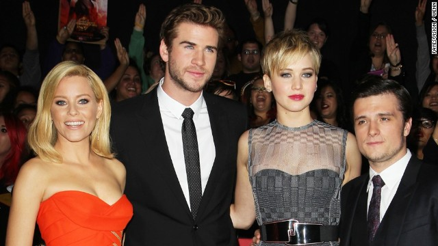 """Catching Fire"" stars Elizabeth Banks, from left, Liam Hemsworth, Jennifer Lawrence and Josh Hutcherson."