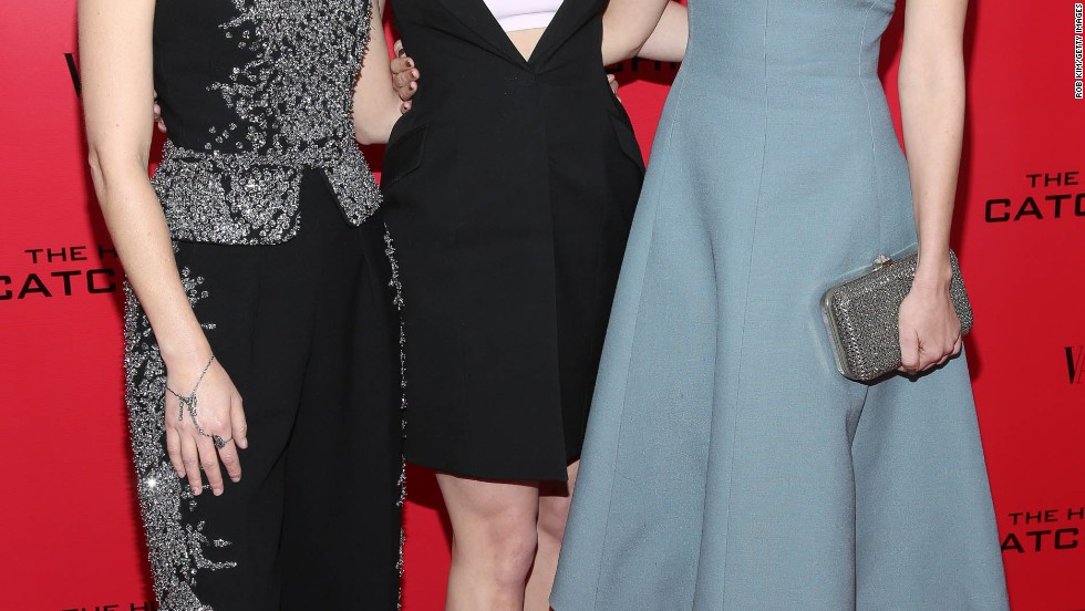 "Elizabeth Banks, Jennifer Lawrence and Jena Malone take in a special screening of ""Catching Fire"" on November 20."