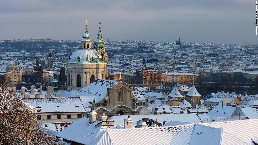Gas street lamps plus stunning architecture under a sheet of snow gives Prague that fairytale look.