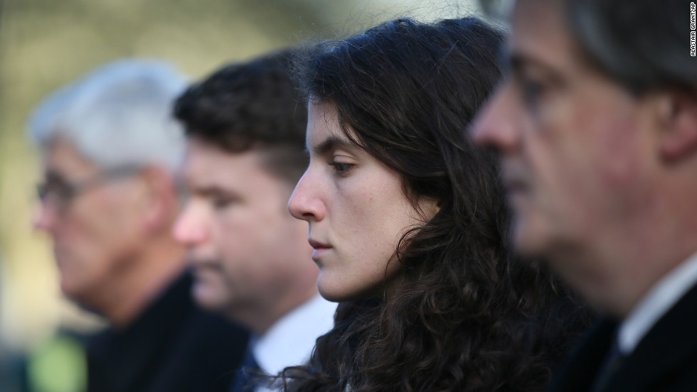 Tatiana Schlossberg, granddaughter of President Kennedy, pauses for a moment of silence during a short ceremony November 22 at the JFK memorial in Runnymede, England.