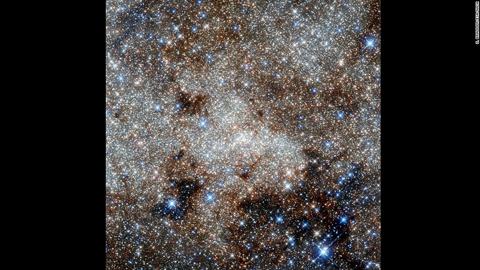 From the Hubble telescope: the crowded center of the Milky Way, showing the constellation Sagittarius. Right in the center of the image is a supermassive black hole called Sagittarius A*, consuming clouds of dust as it affects its environment with its enormous gravitational pull.