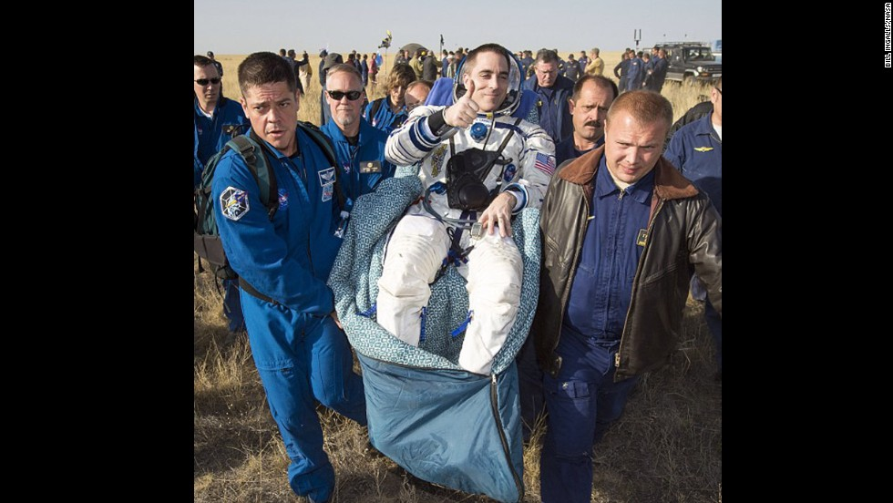 Expedition 36 flight engineer Chris Cassidy of NASA is carried to the medical tent shortly after landing in Kazakhstan on September 11, having spent five and a half months on the International Space Station.