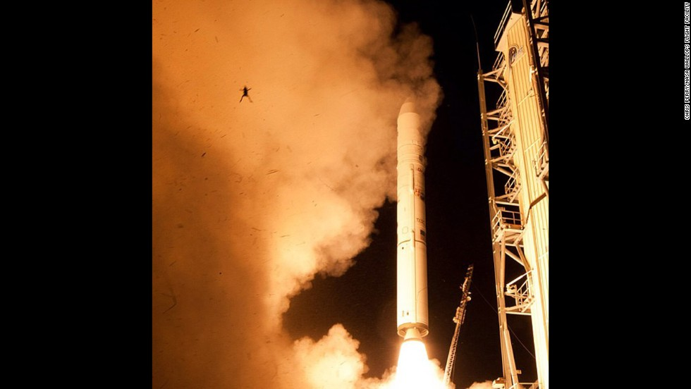 <strong>September 6:</strong> A frog is launched in the air as a rocket takes off at NASA's Wallops Flight Facility in Virginia.