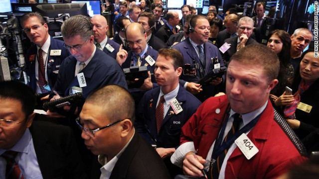 NEW YORK, NY - NOVEMBER 22: People stand near the broker's booth for 500.com Limited (NYSE: WBAI) as it's IPO is set on the floor of the New York Stock Exchange on November 22, 2013 in New York City. 500.com Limited, an online sports lottery service provider in China, opened for trading at $20 after pricing 5,786,000 ADSs. In early trading the Dow Jones Industrial Average was little changed after closing above 16,000 for the first time ever on Thursday. (Photo by Spencer Platt/Getty Images)